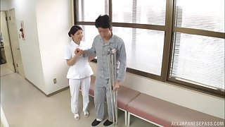 Handsome Asian nurse takes off her clothes while stroking a dick